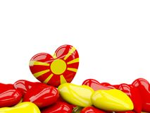 Heart with flag of macedonia. On top of colourfull hearts isolated on white. 3D illustration Stock Photo