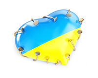 Heart with the flag of ukraine nailed Stock Images