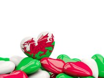 Heart with flag of wales. On top of colourfull hearts isolated on white. 3D illustration Stock Photography