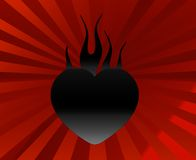Heart with flame motif over a sunburst background Royalty Free Stock Photography