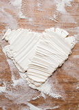 Heart from the flour. Amorous cook made heart from the flour on a cutting board stock image