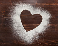 The heart of the flour on the table from the old boards Stock Photo