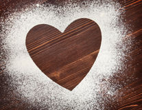 The heart of the flour on the table from the old boards Royalty Free Stock Images