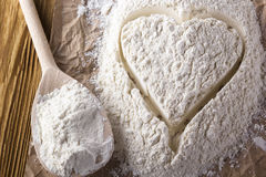 Heart of flour. On the wooden background Stock Image