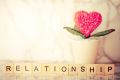 Heart flower pot with relationship text Royalty Free Stock Photography