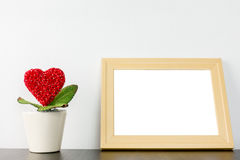 Heart flower in wihite pot with photo frame Royalty Free Stock Photo