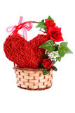 Heart and flowers in a basket on Valentine's Day Stock Photography