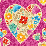Heart with flowers. Large ocher heart with flowers on a bright pink seamless background. Romantic floral wallpaper. It can be used for decorating of wedding Royalty Free Stock Image