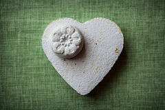 Heart and flowers made of paper mache on a fabric background Stock Image