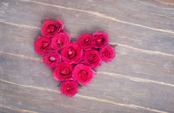 Heart from flowers on the wooden background Stock Photos
