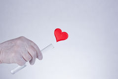 Heart flowing out of test tube Royalty Free Stock Photos