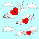 Heart Flying. Valentines heart locks, flying on Angel Wings though cloudy blue sky Stock Photo