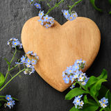 Heart and forget-me-not Stock Image
