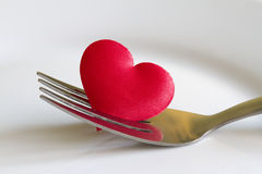 Heart on the fork abstract sign symbol Royalty Free Stock Photos