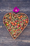 Heart form basket plate with brier fruits Stock Photos