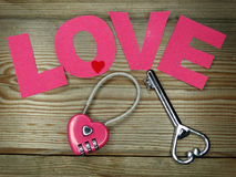 Heart form lock and key valentine`s day love concept Stock Photos