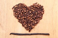 Heart form made from spice cloves Royalty Free Stock Image
