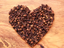 Heart form made from spice cloves Royalty Free Stock Photos