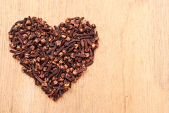 Heart form made from spice cloves Royalty Free Stock Photo