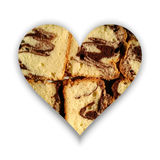 Heart form with slices of cocoa sponge cake royalty free stock image