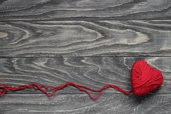 Heart in the form of a string of threads from which a red sweate Royalty Free Stock Photo