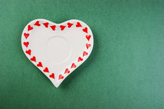 Heart form white plate Stock Image