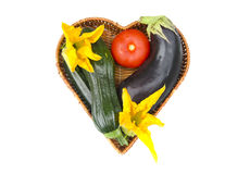 Heart form wicker plate basket and fresh vegetable. Isolated on white. Healthy life concept Royalty Free Stock Image