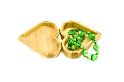 Heart form wooden gift box with jewelry Stock Images