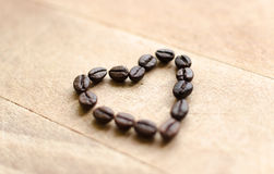 Heart formed from coffee beans Stock Images