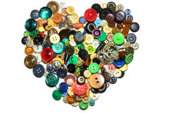 A heart formed with colorful buttons. Isolated against a white background Royalty Free Stock Image