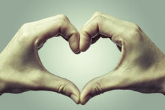 Heart, formed by female hands, color. Stock Images