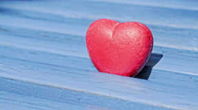 Heart. Formed object between blue wooden planks Royalty Free Stock Image