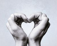 Heart is formed by woman`s hands. Silhouette of the heart is formed by woman`s hands Stock Images
