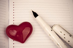 Heart and fountain pen on the blank page Stock Photography