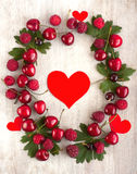 Heart in the frame with berry Stock Image