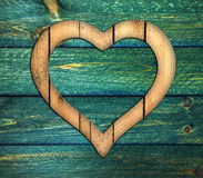 Heart frame border window wooden. Wooden border of hearts shape on the green wooden wall royalty free stock images