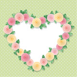 Heart frame decorated with roses on polka dots. With copy space for text or photo. Shabby chic design. Royalty Free Stock Image