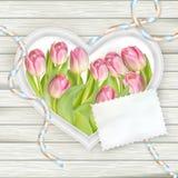 Heart frame with fresh tulips. EPS 10 Stock Photos