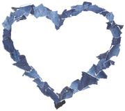 Heart frame made of denim jeans pieces royalty free stock photography