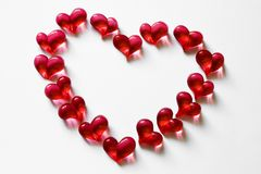 Heart-frame made of glass beads over white. Valentine heart-frame made of glass beads on white royalty free stock photography
