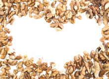 Heart frame made of walnuts Royalty Free Stock Photos