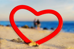 Heart frame by the ocean Stock Photos