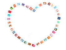 Heart frame, postage stamps. Posting Love messages! - a fun still life arrangement of brightly colored postage stamps from different countries in the world, to royalty free stock photo