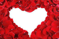 Heart frame by red rose petals Stock Photo