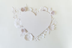 Heart frame with white paper flower Stock Photos