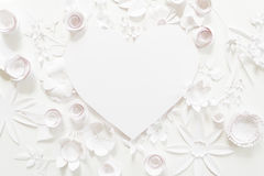 Heart frame with white paper flower Stock Images