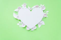 Heart frame with white paper flower Stock Image