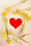 Heart in the frame of wild flowers Royalty Free Stock Photography