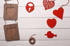 Heart and frame on the wooden table. Valentine's Day. Art. Love Royalty Free Stock Images