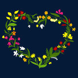 Heart frame with wreath of wildflowers and herbs Royalty Free Stock Photography